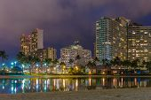 picture of waikiki  - Night view of Waikiki Beach and Diamond Head in Honolulu at night in Hawaii USA - JPG