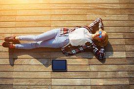 picture of jetties  - High angle shot of carefree young woman in summer glasses lying on the wooden jetty in the sunyoung freelancer woman resting after work with digital tablet outdoors enjoy her holiday or break flare - JPG