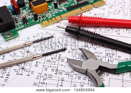 Printed circuit board precision tools and cable of multimeter on printed circuit board with electrical components precision tools and cable of multimeter on construction drawing of electronics engineer jobs poster ccuart Image collections