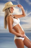 Sexy lady wearing swimsuit and hat on white