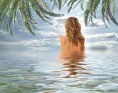 Beautiful woman in a water