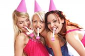 stock photo of young girls  - Three young beautiful girls celebrate birthday isolated over white background - JPG
