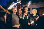 Young People Enjoying New Years Eve With Fireworks poster
