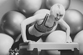 Endurance, Strength And Fitness Concept. Girl In Sportswear Training On Step Platform In Gym. Happy  poster