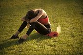 After A Workout. Tired Woman In Sportswear Relax After Workout, Training. Sportswoman Sit On Green G poster