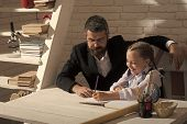 Home Schooling. Kid And Man Sit By Desk With School Supplies. Schoolgirl And Her Dad With Happy Face poster