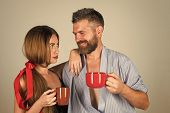 Family Drinks Morning Coffee. Refreshment And Energy, Break. Man And Girl With Mulled Wine On Grey B poster