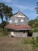 stock photo of sag  - Florida lightkeepers house that has fallen into disrepair - JPG