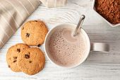 Tasty Cookies And Mug With Hot Cocoa Drink On Table, Top View poster