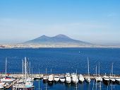 Awesome Landscape From Napoli Of Yachts Sea Mount With City In Distance And Blue Sky poster