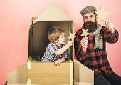 Kid Playing With Paper Star In Space Rocket. Boy Play With Cardboard Rocket. Son Play With Father. F poster