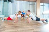 Children At Physical Education Lesson In School Gym poster