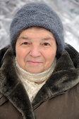 Portrait Of An Old Woman In Winter