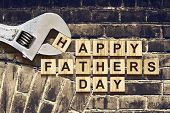 Happy Fathers Day Inscription On Wooden Cubes With Working Tools On An Old Vintage Brick Wall. Happy poster