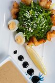 Top View - Sea Kale Salad Sprinkled With Sesame Seeds With Fried Fish Slices With Two Slices Of Boil poster