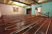 Pipefitter Installing System Of Heating Or Underfloor Heating Installation. Water Floor Heating Syst poster