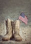 Old Military Combat Boots With The American Flag. Rocky Gravel Background With Copy Space. Memorial  poster