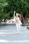 Happy Girl Run In Summer Park. Small Child Smile With Flying Hair In Motion. Summer Activity And Hap poster