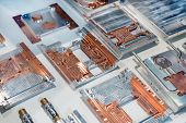 Aluminum-copper Heat Sink Plates For Industrial Electronics. Equipment For Cooling Electronic Compon poster