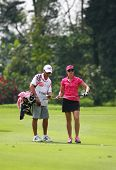 KUALA LUMPUR, MALAYSIA - OCTOBER 16: Paula Creamer discusses with her caddie on hole #9 on day 4 of the Sime Darby LPGA Malaysia 2011 golf tournament on Oct 16, 2011 in Kuala Lumpur, Malaysia.