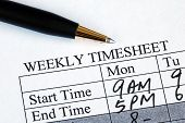 stock photo of payroll  - Enter the weekly time sheet concepts of work hours reporting - JPG