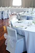 stock photo of wedding table decor  - Tables decorated in white at a wedding reception - JPG