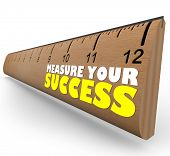 A wooden ruler with the words Measure Your Success, representing a review, evaluation or assessment