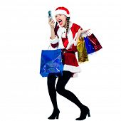 one woman dressed as santa claus carrying screaming on the telephone christmas bags  on studio isola