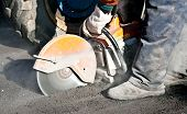 stock photo of petrol  - Cutting road works with petrol driven angle grinder - JPG