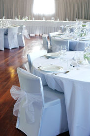 picture of wedding table decor  - Tables decorated in white at a wedding reception - JPG