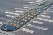 Speed Bump On A City Street. Speed Bump And Road Markings On The Pavement. Road Traffic Safety. Pede poster