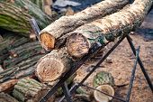 Sawn Old Logs. Stack Of Logs In A Lumber Mill. Stack Of Firewood. Logs For The Fireplace. Harvesting poster