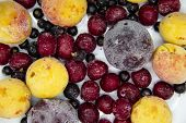 A Berry Mix From Frozen Currant, Apricot, Plum, Cherry. A Frozen Berries From Freezer. A Sweet Backg poster