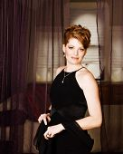 stock photo of evening gown  - Beautiful redheaded model in evening gown and wrap - JPG