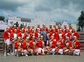 SUMY - JUNE 28: Female Brass Band posing for a group photo at celebration of the Day of Constitution