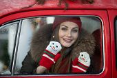 Belarus Minsk 16 12 2019:pleasant Fashionable Winter Girl Smiling Posing At Red Vintage Car Surround poster