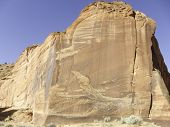 Tall Sandstone Cliff Bright Blue Sky