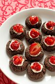 Chocolate thumbprint cookies with cream cheese and strawberries