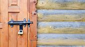 Old Wooden Door With A Black Metal Bolt. Close Up View Of A Lock And Latch On A Wooden Door. Rustic  poster