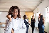 Front View Of Young Woman With Dreadlock Holding Marker. Confident African American Businesswoman Lo poster