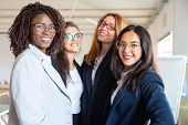 Group Of Confident Young Businesswomen Looking At Camera. Beautiful Smiling Women Posing. Female Con poster