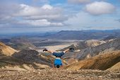 Hiker Standing On His Hand In The Landmannalaugar Valley. Iceland. Colorful Mountains On The Laugave poster