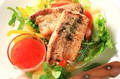foto of pork belly  - Fresh tomato and lemon juice with fried pork belly on lettuce - JPG