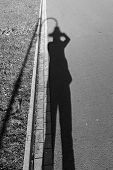 Selfies With A Shadow And A Street Lamp Like A Hat In Street Photography. Black And White Street Pho poster
