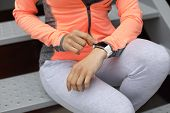 Detail Of Sporty Woman Checking Workout Goals On Fitness Tracker. Female Athlete Getting Ready For R poster