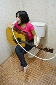 Play The Guitar In The Bathroom.
