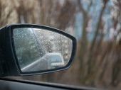 Rain Behind The Glass Of A Car. Rain Droplets Flow Down The Car Glass. Rain Behind The Windshield Of poster