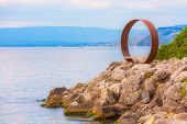 Panoramic View Of Lake Geneva, Switzerland And Viewpoint Bench In Round Metal Circle poster