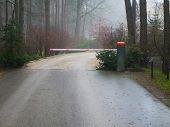 Closed Forest Barrier. Country Road In The Forest With A Closed Red White Barrier. The Protection Of poster