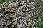 Clear Spring Water Flows On Beautiful Stony Steep Slope. Boulder Stream With Small Mountain Creek. M poster
